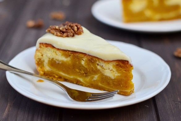 Delicious Pumpkin Swirl Cheesecake made of two parts: pumpkin mix and cheese mix, swirled together into a beautiful cake covered with cream cheese frosting.
