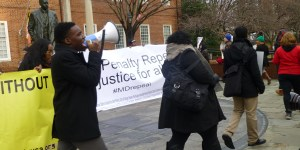 Howard University senior Stanford Fraser, left, leads Death Penalty Repeal Rally in front of the Maryland Statehouse.