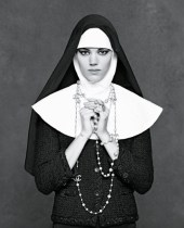 Image from Chanel's The Little Black Book featuring a model styled as a nun wearing the classic Chanel Jacket.
