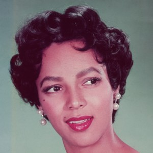 Dorothy Dandridge, like beauty icon, Marilyn Monroe, inspired today's defined dark brow with bold lips look.