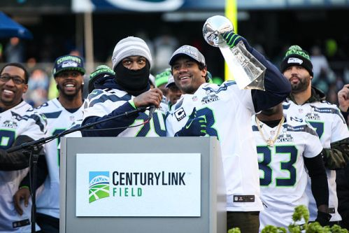 Following in Doug Williams' cleats, quarterback Russell Wilson celebrates the Seahawks' Super Bowl victory on home turf in Seattle.