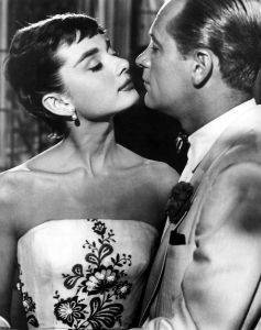 "Audrey Hepburn stood out for her bangs. She's shown here with William Holden in a scene from the film ""Sabrina"" in 1954."