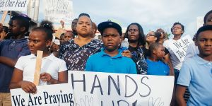 """Hands up! Don't shoot!"" signs displayed at Ferguson protests"