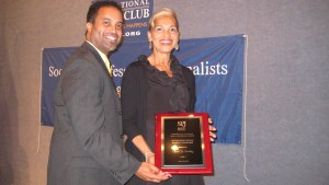 Alumnus Keith Alexander presented the Society of Professional Journalists' award to Carol Dudley for Distinguished Service to Local Journalism.