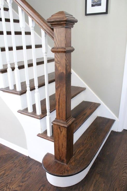 The chunky new newel post makes a world of difference. We stained it ...