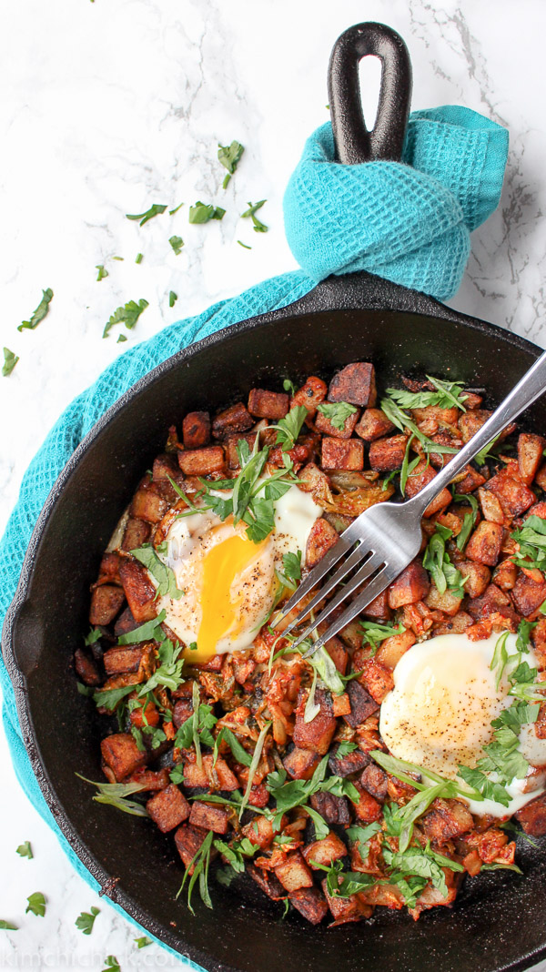 Kimchi Potato Hash has golden crispy home fries, spicy kimchi, and tender fatty pork belly, all in one hot skillet. Enjoy this beauty for brunch!