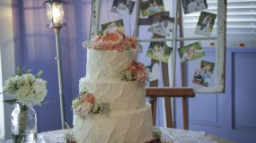 Romantic rustic wedding cake with pink flowers