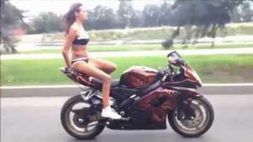 Girl in bikini dangerous riding a motorcycle