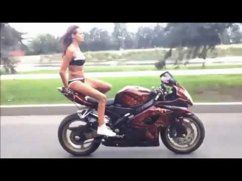 Girl in bikini dangerous riding a motorcycle