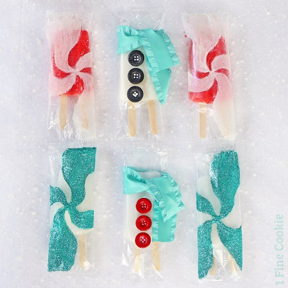 winter wonderland decorated popsicles, winter, white, popsicles, red, glitter, peppermint, swirl, santa, craft, food, idea, party, turquoise, red, white, palette, color, scheme, theme, snowman, cute, diy, homemade, holidays,