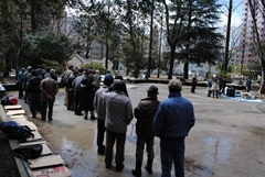 People line up for a soup kitchen organized by a Sendai-based NPO with aid from AMDA