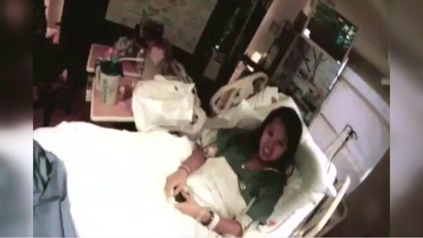 21WIRE RESIZE IMAGE - Nina+Pham+hospital+bed.jpg