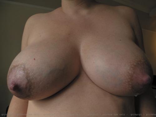 huge lactating breasts captions