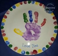 Multicoloured handprint and fingerprints