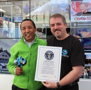 Apa Sherpa and Michael Kintner holding the Guinness Book of World Records Certificate for the first 360 Video on top of Mount Everest