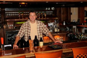 Post - Mike Kainz Behind the Bar at Wild Onion Brewery in Lake Barrington