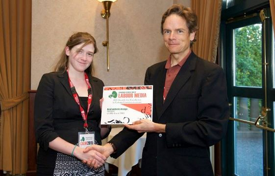 3903's delegate accepts the best website design award at the annual Calm Awards.