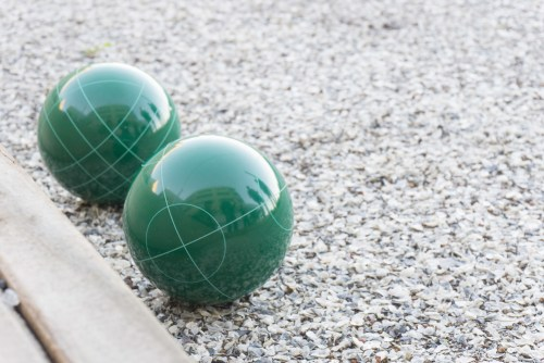 green bocce ball and reflections