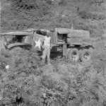 Neal Willis and his wrecked 6x6 on Corsica