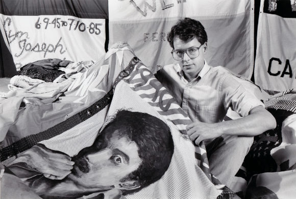 Jones with a panel from the AIDS Quilt.