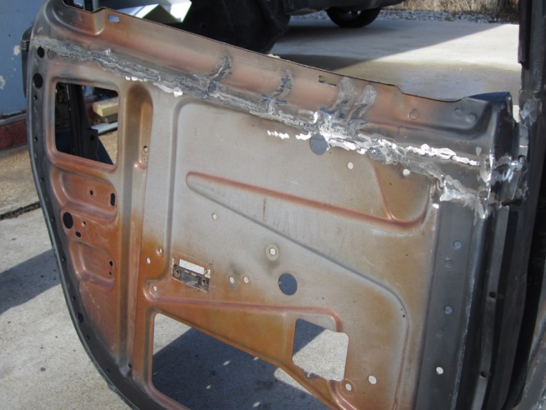 Rear Door with metal removed, vertical stress cuts to curve the top frame & welded back together again.