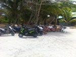 A shot of the gang and our rides. Stopping for a cool beverage on our long journey around the island.