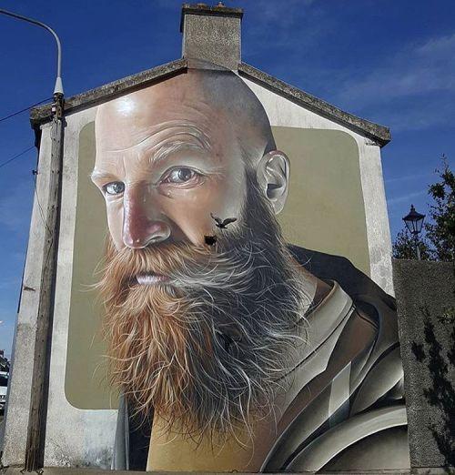 bizarrebeyondbelief:  Ne week by @smugone in Ireland for @waterfordwalls #smugone #streetart #hyperrealism #waterfordwalls