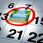 Vacation plan traveling concept and planning your trip as a calendar date reminder with a sunny beach and palm trees highlighted with a red marker as a symbol of planning a fun relaxing holiday event.