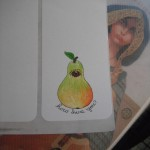A book by Monica Furlong and a pear hand drawn sticker by Artisan Of Whimsy