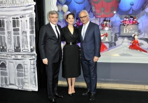 Actress and face of Dior Marion Cotillard, accompanied by the president and director general Paolo de Cesare to the left and chief executive officer of Dior SidneyToledano stands in front of one of the eleven holiday window displays that debuted November 9. *Photo Credit: Zimbio