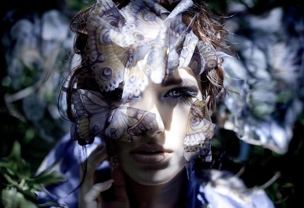 blue butterfly fashion covers model's face