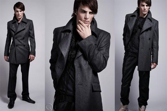 Man posing in gray pea coat