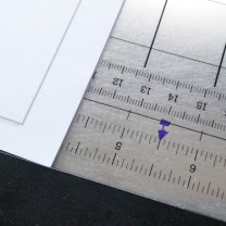 """Step 1: Measure paper to find center. Should be 5 1/2""""."""