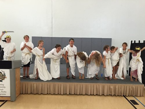 the cast in toga bed sheets
