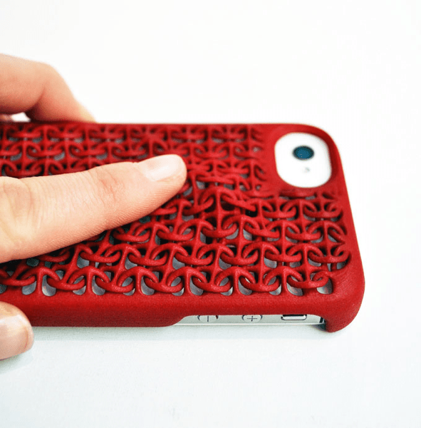 Finger pushing the Maille Case