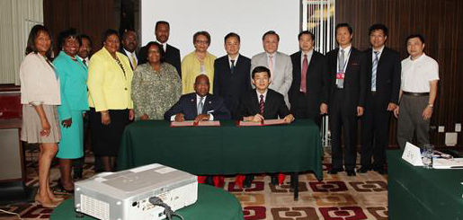 Eight American Historically Black Colleges and Universities sign a Memorandum of Understanding with the China Education Association for International Exchange (CEAIE) in Beijing, China on July 9, 2014. Dr. David Wilson (seated left) signed the MOU on behalf of the delegation of senior administrators from Bowie State University, Hampton University, Howard University, Morehouse College, Morgan State University, Spelman College, Tougaloo College and Xavier University of Louisiana.