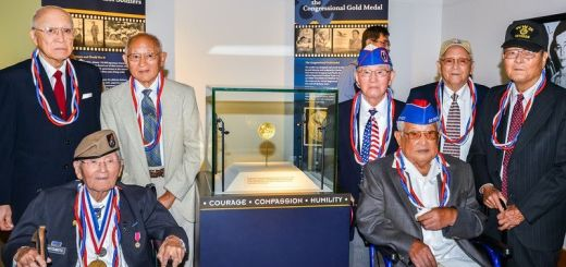 100th, 442nd and MIS veterans pictured in front of the Congressional Gold Medal display at the Oregon History Society exhibit during the Portland Oregon stop from August 24 - September 29, 2013
