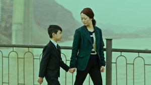 Zhao Tao in a scene with a young boy in director Jia Zhangke's film 'Mountains May Depart'. (Photo courtesy of Kino Lorber)