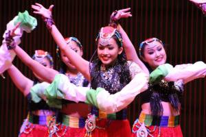 Young Hmong women dance in costume at the Ordway.