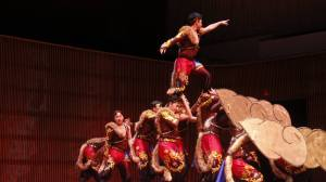 Young Hmong men show their acrobatic and artistic abilities.