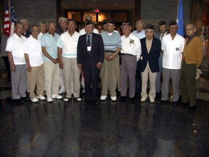 Edwin Nakasone Ph.D., center, and other MISLS graduates of Camp Savage and Fort Snelling at the Minnesota History Center in 2002.