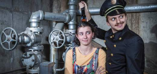 Sasha Hixson '19, New York, N.Y., as Little Sally and Michael Karadsheh '18, Holland, Mich., as Officer Lockstock lead the cast of Urinetown the Musical.