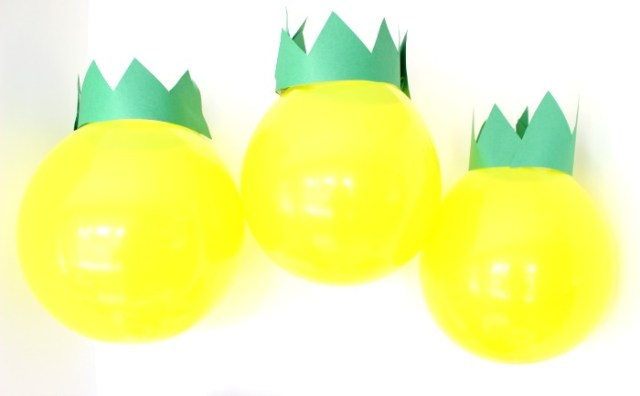 Pineapple decoration with a yellow balloon and green paper