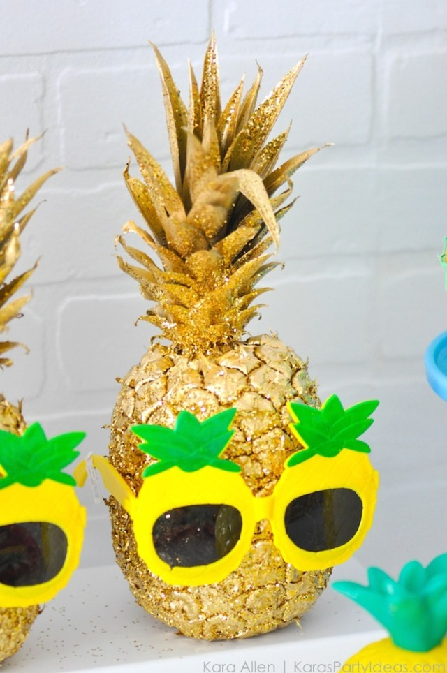 Pineapple spray painted gold with gold glitter and pineapple sunglasses