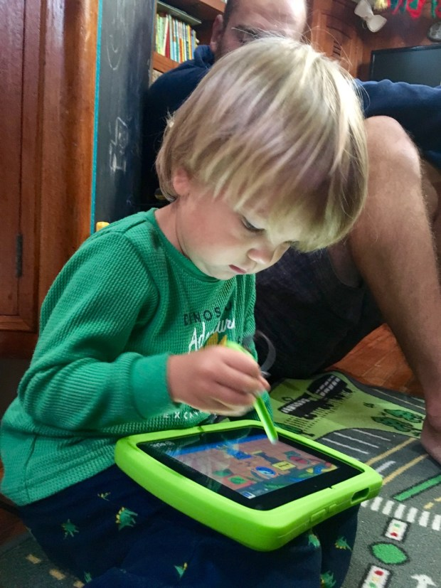 We got him a LeapFrog tablet. We like the parental controls - otherwise this is what he would look like all day!