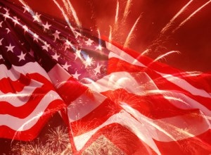 fireworks over waved United States flag
