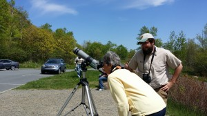 Patrick Kark, right, helps a visitor spot a nesting peregrine falcon.