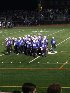 The Eagles huddle before beginning the second half.