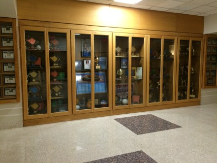 The trophy cases outside of the senior high gym celebrate all of the school's athletic accomplishments. Photo by Ariane Cain