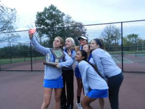 Team members celebrate and commemorate their first county championship in 2014. (Photo: Amanda Cain)